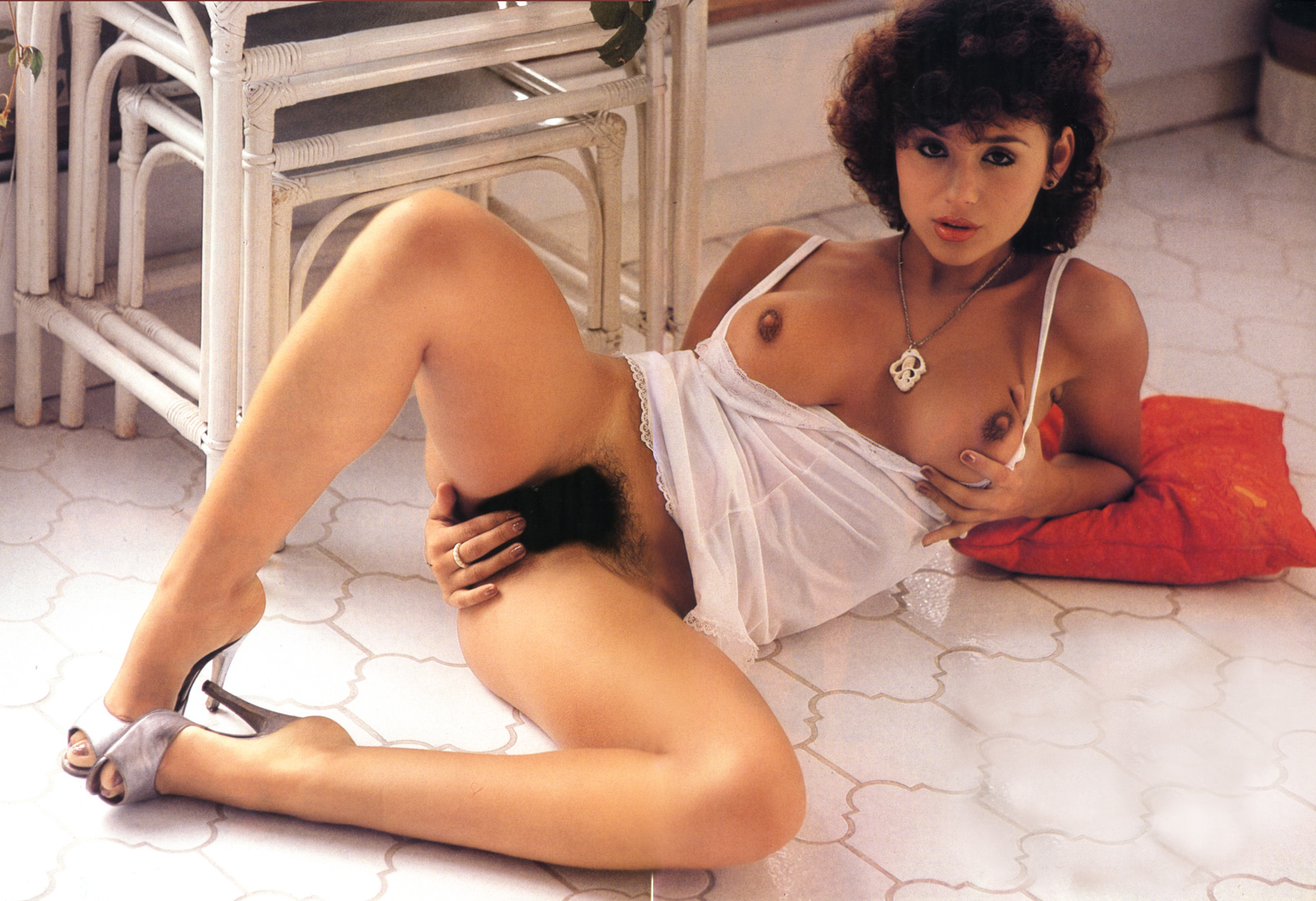 Retro downblouse Ava Cadell in erotic scene a nice downblouse.